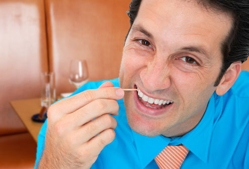 getty_rf_photo_of_man_picking_teeth_with_toothpick-1